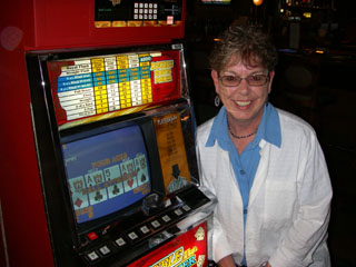 Shar, with one of her sets of Aces on a dollar DB machine, shown to the right.